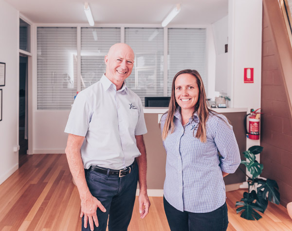 John Meade physiotherapist and receptionist Kristy in clinic foyer