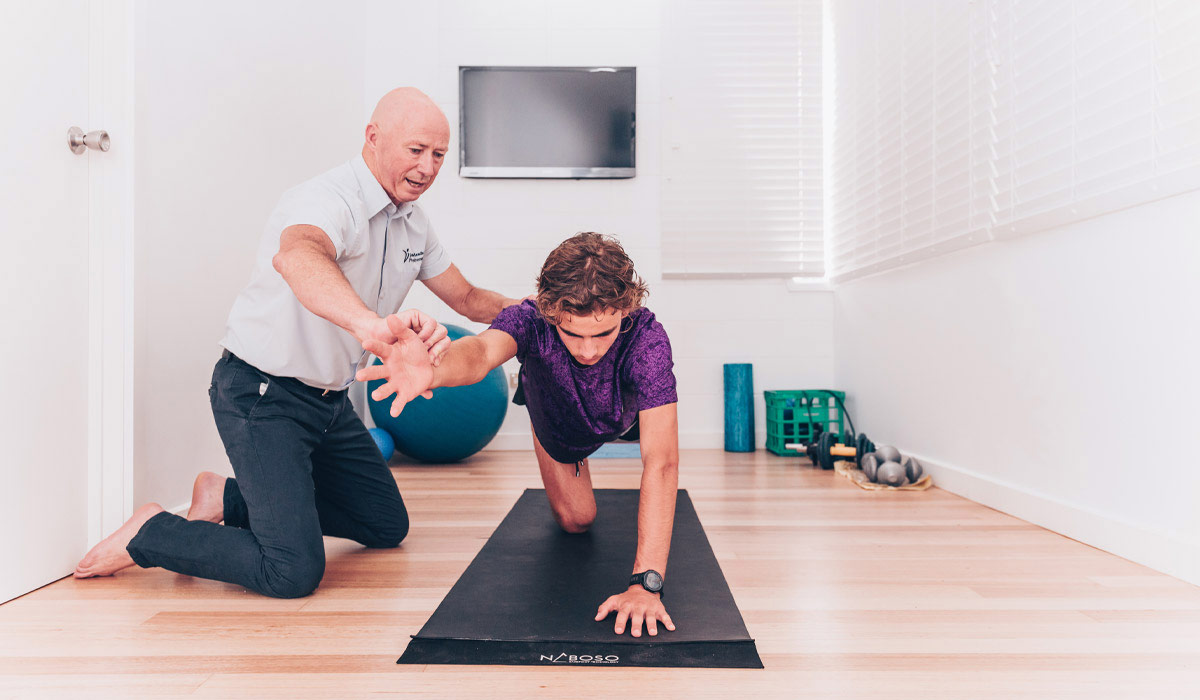 John Meade in treatment gym with movement training patient